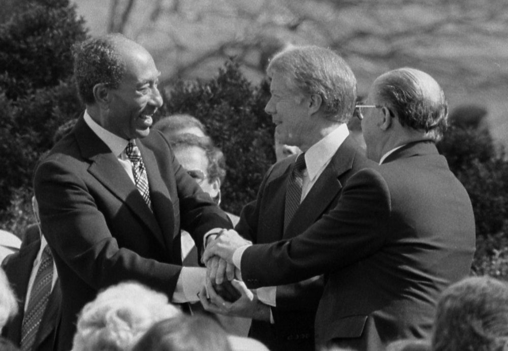 U.S. President Jimmy Carter shaking hands with Egyptian President Anwar Sadat and Israeli Prime Minister Menachem Begin at the signing of the 1979 Egyptian-Israeli Peace Treaty on the grounds of the White House. Israel hopes a cut in U.S. military aid to Egypt won't affect the treaty. Credit: Library of Congress.