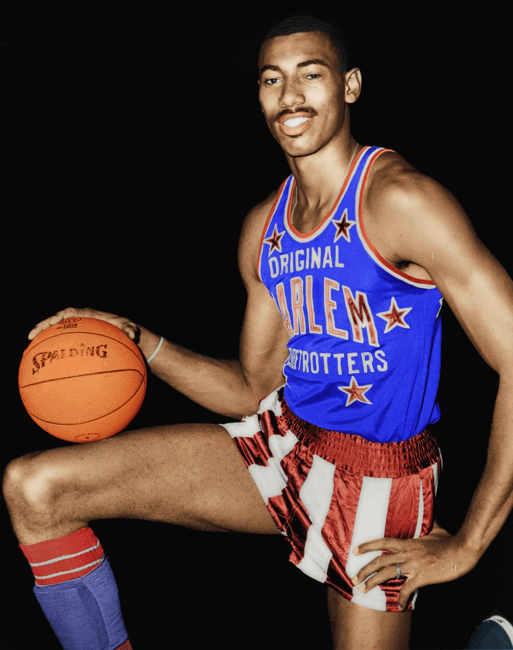 Click photo to download. Caption: Wilt Chamberlain wearing his Harlem Globetrotters uniform in 1959. He played one season for the team, after which Jewish basketball pioneer Eddie Gottlieb convinced him to leave for the Philadelphia Warriors. Credit: Fred Palumbo, World Telegram staff photographer via Wikimedia Commons.