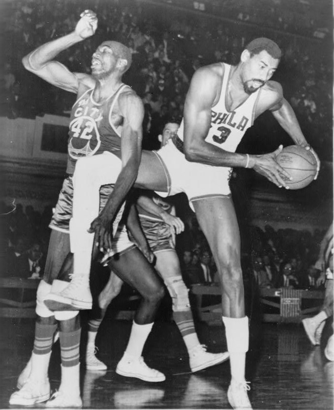 Click photo to download. Caption: Wilt Chamberlain, playing for the Philadelphia 76ers, faces Nate Thurmond of the San Francisco Warriors in 1966. Credit: Library of Congress.