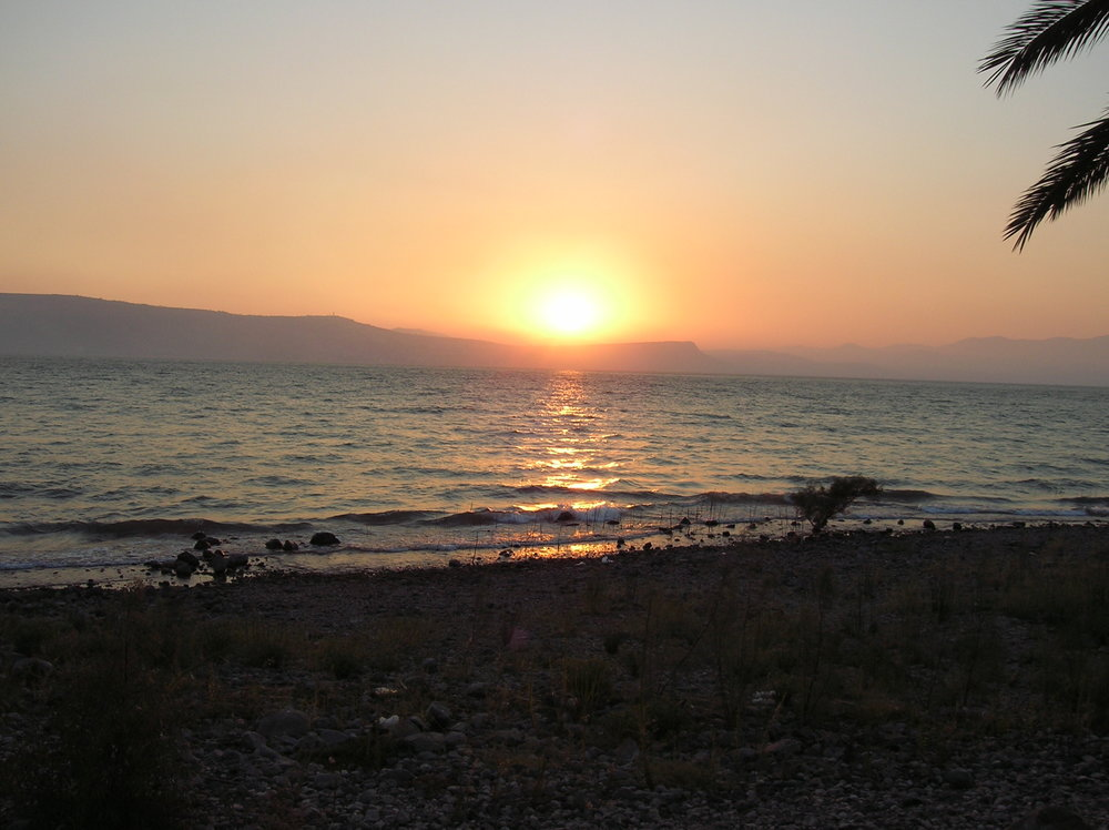 A sunset over Israel's Sea of Galilee. Sediment samples from under the sea suggest widespread drought led to collapse of Bronze Age civilizations. Credit: Wikimedia Commons.