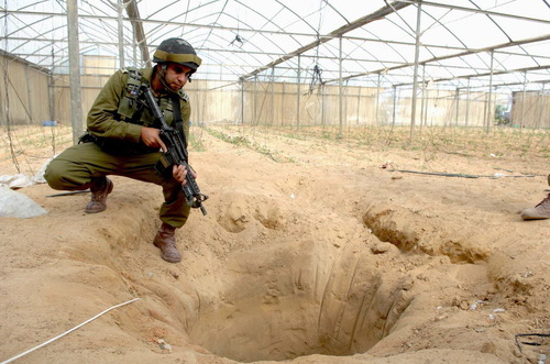 An IDF soldier pictured in 2006 at a tunnel uncovered during an Israeli<br /> counter-terrorism operation designated to thwart weapons smuggling from<br /> Egypt to Gaza through the Philadelphia Route, in southern Gaza. Credit:<br /> Israeli Defense Forces.