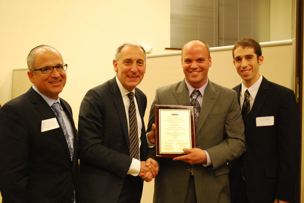 Click photo to download. Caption: Hillel CEO Eric Fingerhut, second from left, on Oct. 10 presents the University of Illinois at Urbana-Champaign's (UIUC) Illini Hillel with a plaque celebrating its 90th anniversary. UIUC was the birthplace of the Hillel movement. Holding the plaque is Erez Cohen, director of Illini Hillel. Credit: Hillel: The Foundation for Jewish Campus Life.