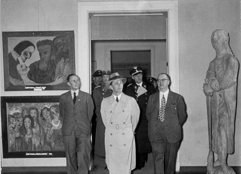 "Nazi propaganda minister Joseph Goebbels (center) at an exhibition of ""degenerate"" art. Credit: Wikimedia Commons."