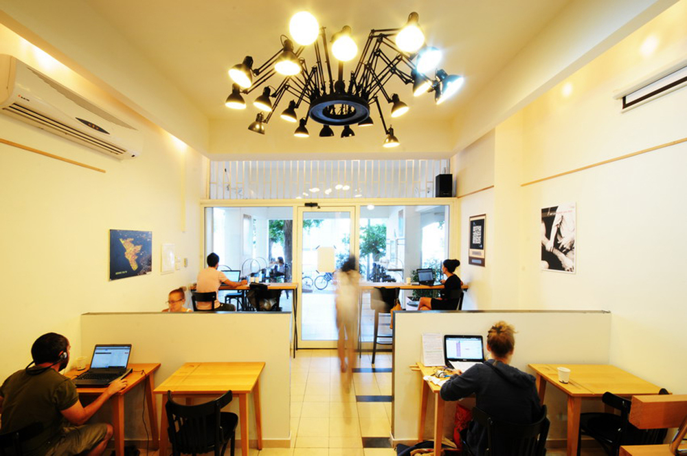 "Click photo to download. Caption: ""Misanthrope,"" a shared workspace in Tel Aviv that is a haven for Israeli writers. In return for a small hourly fee, Misanthrope customers enjoy unlimited free coffee, fresh fruit, WiFi, and a comfortable public quiet space to work on personal projects. Credit: Misanthrope."