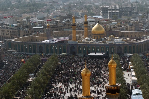 Click photo to download. Caption: Shi'a Muslims gather around the Husayn<br />Mosque in Karbala, Iraq, after making a pilgrimage on foot during Arba'een,<br />a 40-day period that commemorates the killing of Hussein ibn Ali, grandson<br />of the Prophet Muhammad, and 72 of his followers at the Battle of Karbala<br />in the year 680AD. That battle is seen as a source of the ongoing battle<br />between Sunni and Shi'a Islam. Credit: SFC Larry E. Johns, USA via<br />Wikimedia Commons.