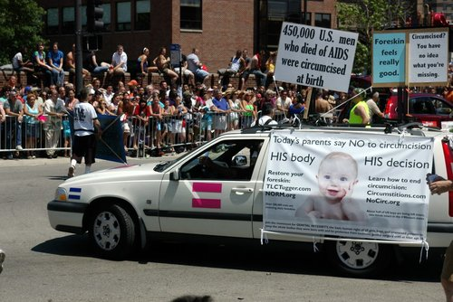 Click photo to download. Caption: A protest against circumcision in<br />Chicago. Credit: Andrew Ciscel via Wikimedia Commons.