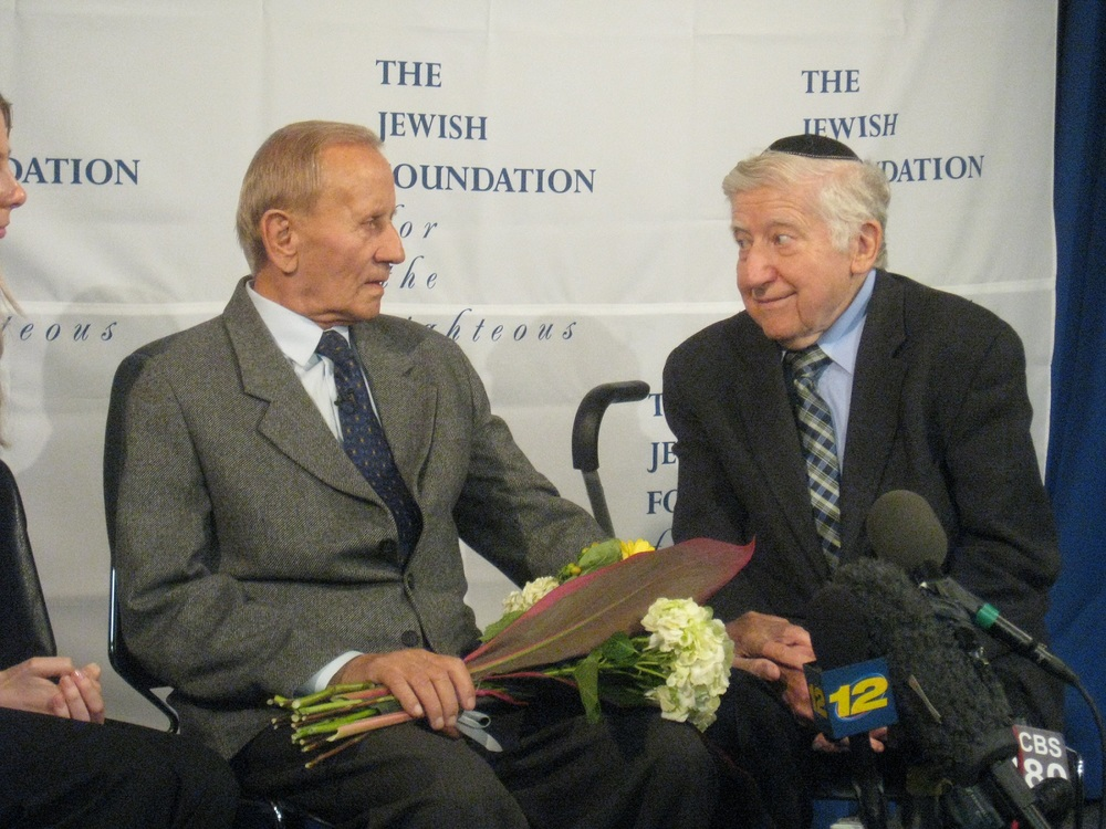 Click photo to download. Caption: The Nov. 27 reunion at JFK International Airport between righteous gentile Czeslaw Polziec (left) and Holocaust survivor he rescued, Dr. Leon Gersten. Credit: Jewish Foundation for the Righteous.