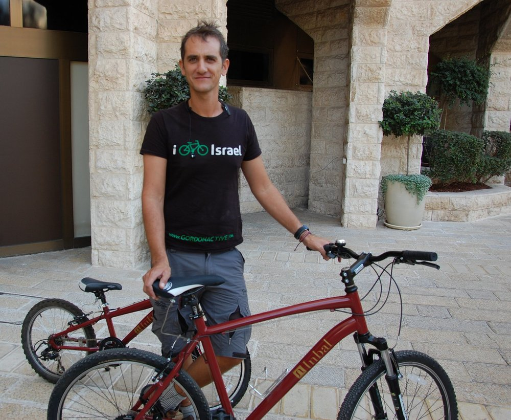 Click photo to download. Caption: Amir Rockman, bicycle director of Israeli tour operator Gordon Active, outside the Inbal Hotel in Jerusalem. Credit: Barry A. Kaplan.