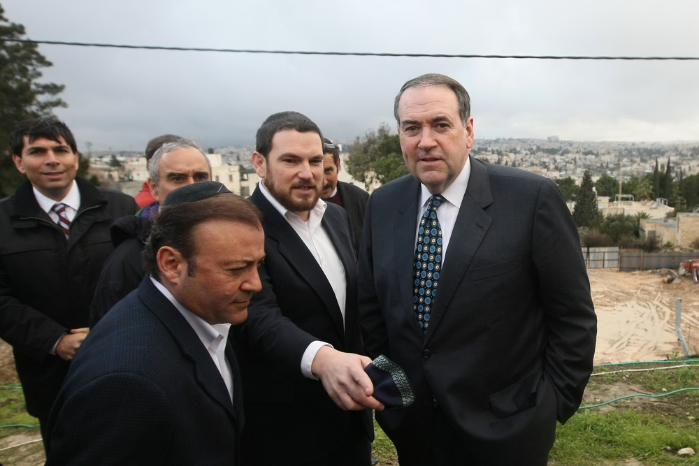 Click photo to download. Caption: Former Arkansas governor and 2008 presidential candidate Mike Huckabee (left) during a visit with Knesset members and Jerusalem councilmen to the eastern Jerusalem Jewish neighborhood of Beit Orot on January 31, 2011. Credit: Kobi Gideon/Flash90.