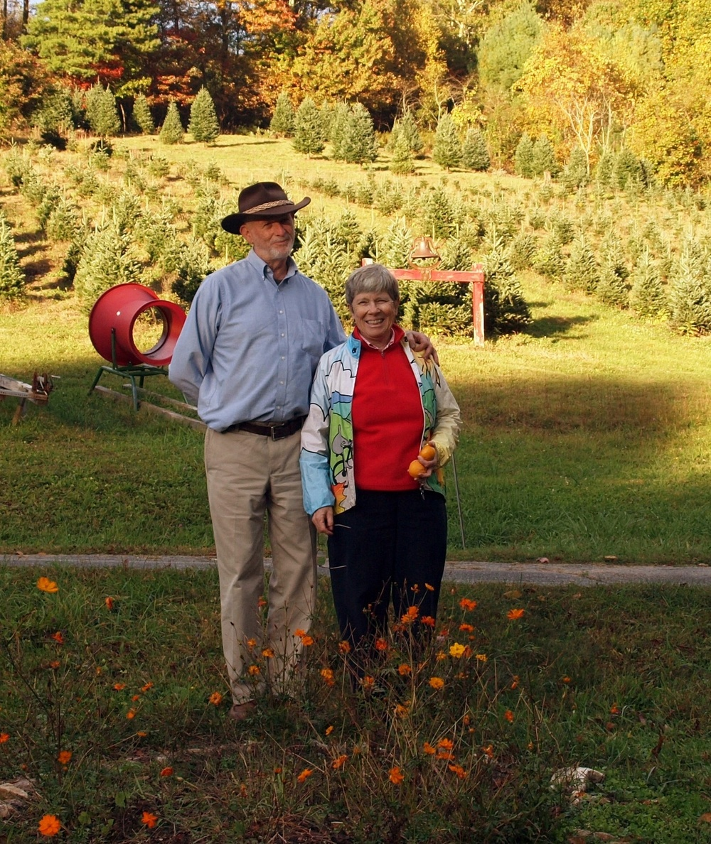 "Click photo to download. Caption: Chuck and Eleanor Lieberman on their Swinging Bridge Farm in Deep Gap, North Carolina. Chuck jokingly calls himself the ""President of the North Carolina Jewish Christmas Tree Growers Association."" Credit: Beth Jacquot."