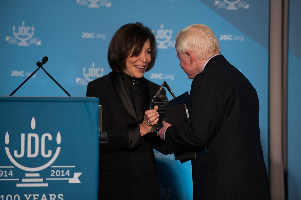 Click photo to download. Caption: Penny Blumenstein, the new president of JDC, presents José L. Cuisía, Philippine ambassador to the United States, with JDC's Or L'Olam Award on Dec. 11 in Washington, DC. Credit: Richard Greenhouse for JDC.