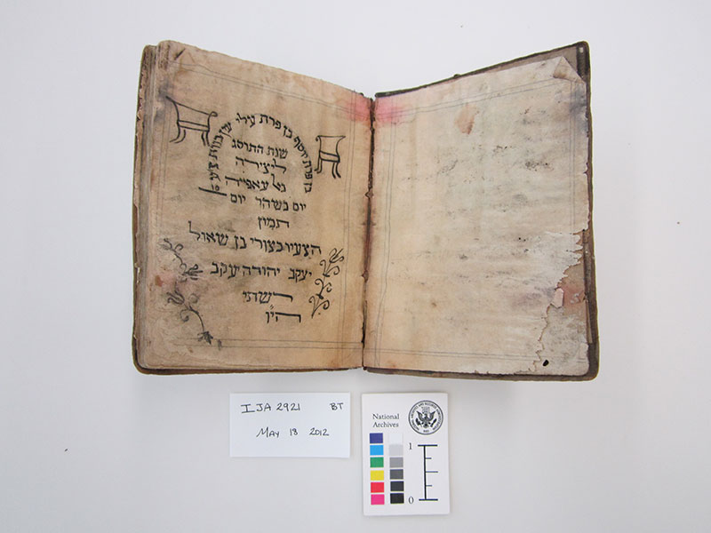 Click photo to download. Caption: The manuscript of a Passover haggadah that is part of the Iraqi Jewish Archive, books and documents which are on display in Washington, DC, but are set to return to Iraq after the Washington exhibition. Iraqi Jews say the Iraqi government confiscated the materials from them. Credit: National Archives and Records Administration.