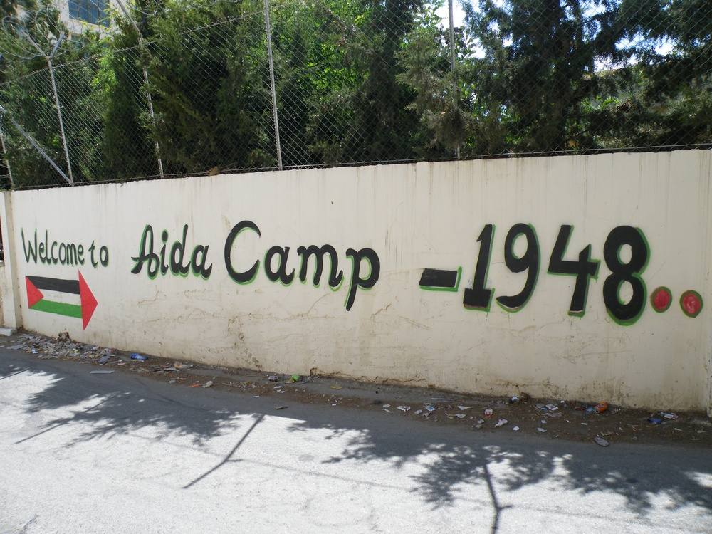 "Click photo to download. Caption: The entrance to the Aida Palestinian refugee camp. A writer on the website of the ""U.S. Campaign for the Academic and Cultural Boycott of Israel"" compares the situation of Aida with the bombing by the German Luftwaffe of the Basque city of Guernica in 1937, during the Spanish Civil War. In its quest to portray the Palestinians as the most oppressed people on earth, there are few comparisons to which BDS proponents won't stoop, writes columnist Ben Cohen. Credit: Mrbrefast via Wikimedia Commons."