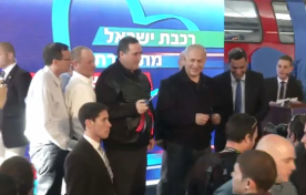 Israeli officials, including Prime Minister Benjamin Netanyahu, at the inauguration of a new train station in Sderot. Credit: Israel Hayom video screenshot.