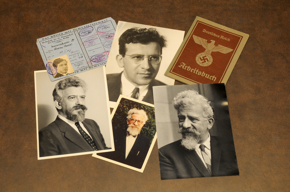 Click photo to download. Caption: Photographs and other items from the Abraham Joshua Heschel Papers at Duke University's David M. Rubenstein Rare Book & Manuscript Library, including a 1935 Nazi-issued work permit. Credit: Duke University.