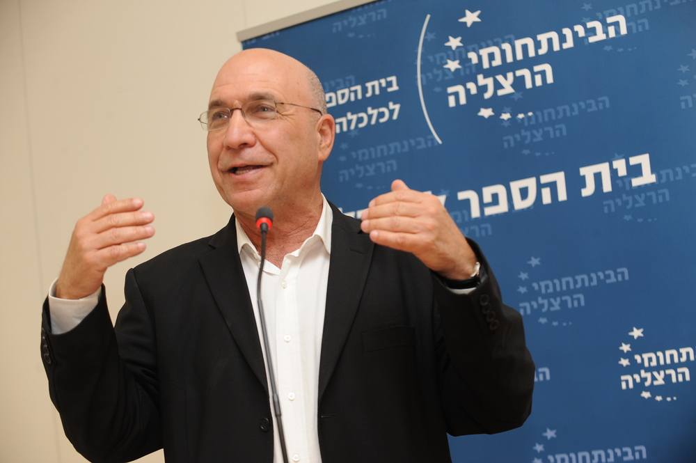 "Click photo to download. Caption: Zvi Eckstein, co-author of the 2012 book ""The Chosen Few: How Education Shaped Jewish History"" and dean of the School of Economics at the Interdisciplinary Center in Herzylia, Israel. Credit: Courtesy of Zvi Eckstein."