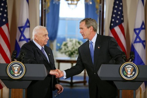 Former Israeli Prime Minister Ariel Sharon shakes hands with former U.S. President George W. Bush at the White House in 2004. Credit: White House