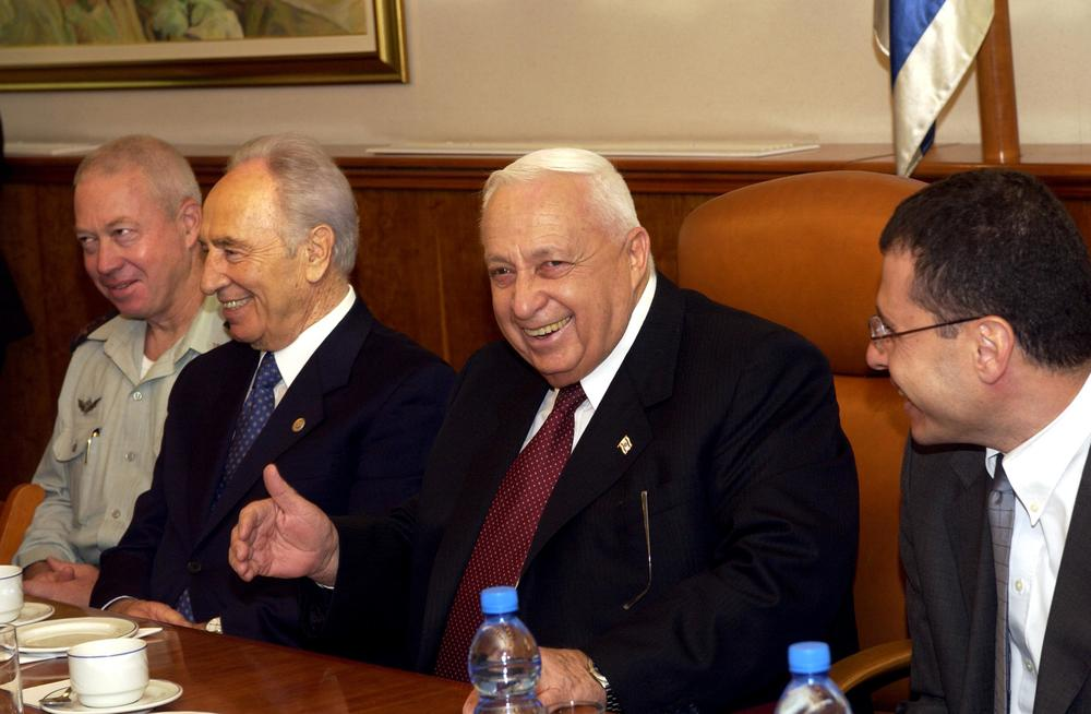 Click photo to download. Caption: Shimon Peres (second from left) and then-Prime Minister Ariel Sharon seen during the 80th birthday celebration for Peres in the Prime Minister's Office in Jerusalem on September 21, 2003. Crediit: Avi Ohayon/GPO/Flash90.
