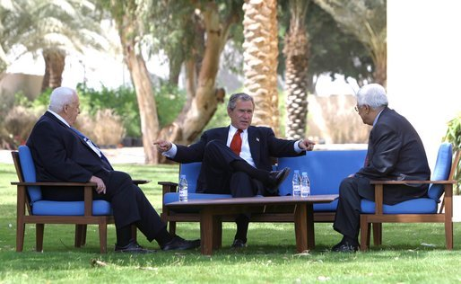 Ariel Sharon, George W. Bush, and Mahmoud Abbas meet in 2003. Credit: Wikimedia Commons.