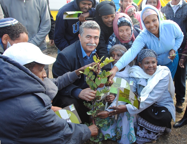 More than 400 Ethiopian immigrants living in absorption centers in Israel planted trees in honor of the Tu B'Shevat, which begins Wednesday evening.