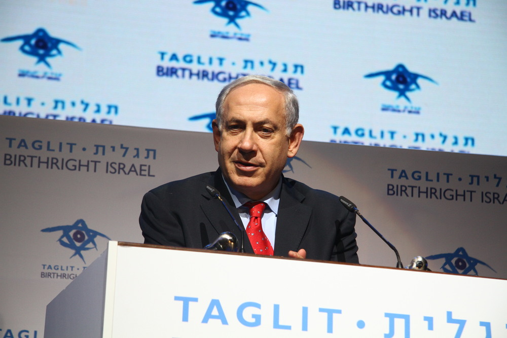 Prime Minister Benjamin Netanyahu addresses the Birthright mega-event on Tuesday. Credit: Asaf Lev.