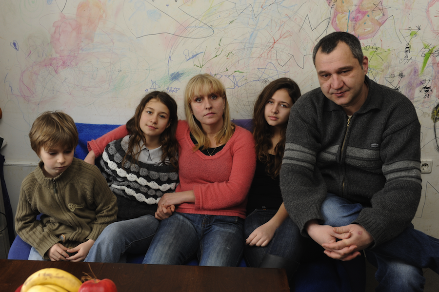 Click photo to download. Caption: With no money to replace the decayed wallpaper in their poorly insulated three-room apartment in Bulgaria, parents Harry and Yana allowed their three children to simply draw on the walls to bring cheer to their home. Economic hardships afflicting Europe pose a dire a threat to Jews, writes Alan H. Gill, CEO of the American Jewish Joint Distribution Committee (JDC).Credit: JDC.