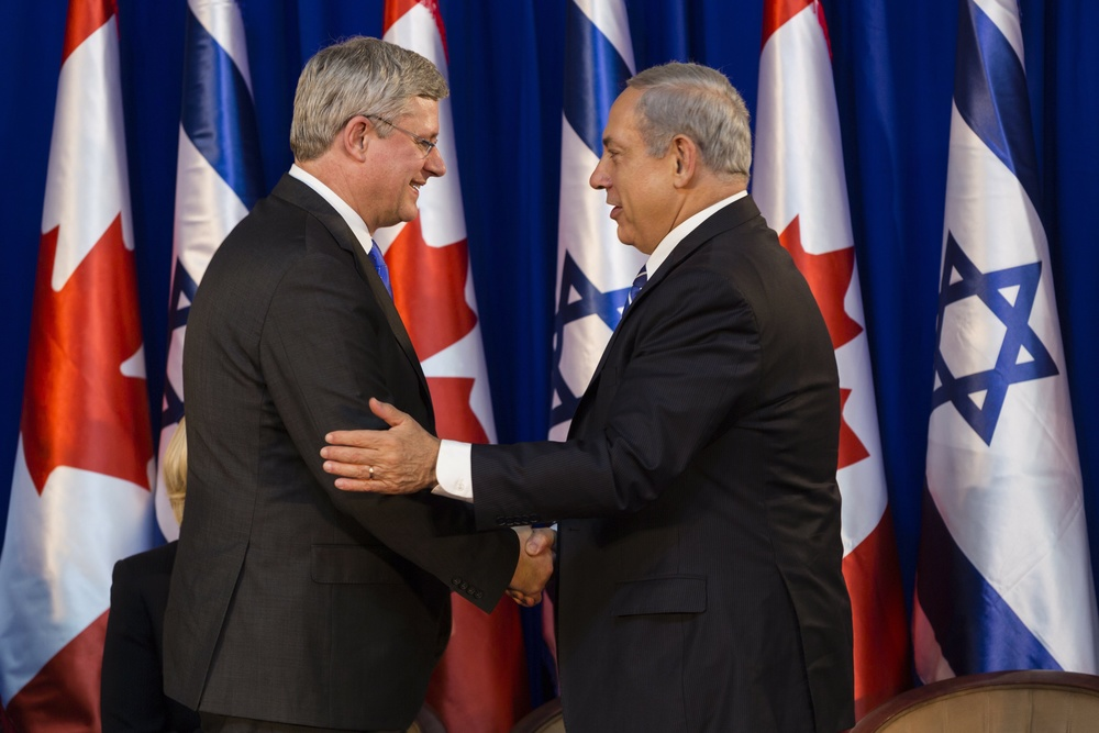 Click photo to download. Caption: Israeli Prime Minister Benjamin Netanyahu (right) shakes hands with Canadian Prime Minister Stephen Harper during a welcoming ceremony for Harper at Netanyahu's office in Jerusalem on Jan.19, 2014. Harper took a four-day trip to Israel and the Palestinian territories. Credit: Flash90.