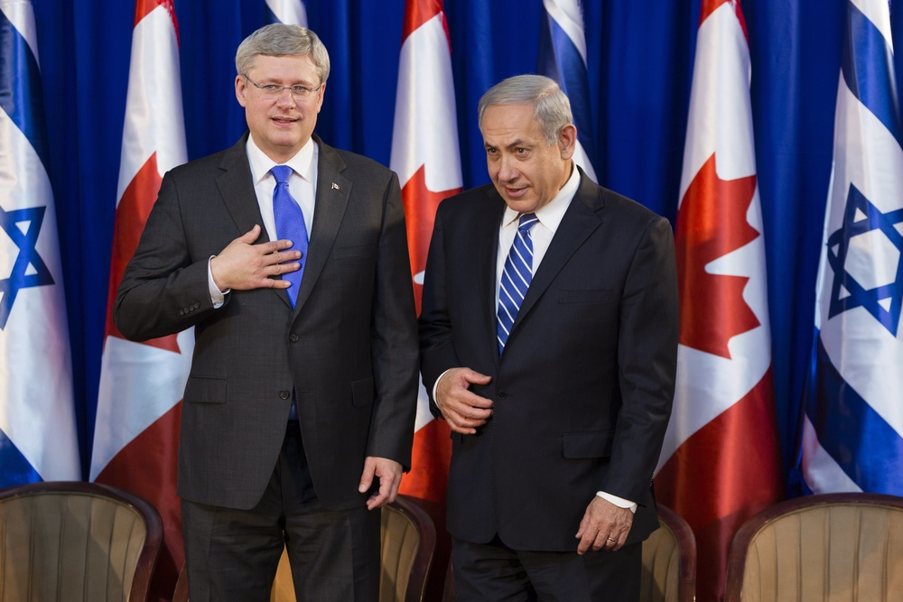 Click photo to download. Caption: Israeli Prime Minister Benjamin Netanyahu (right) with Canadian Prime Minister Stephen Harper during a welcoming ceremony for Harper at Netanyahu's office in Jerusalem on Jan.19, 2014. Harper took a four-day trip to Israel and the Palestinian territories. Credit: Flash90.