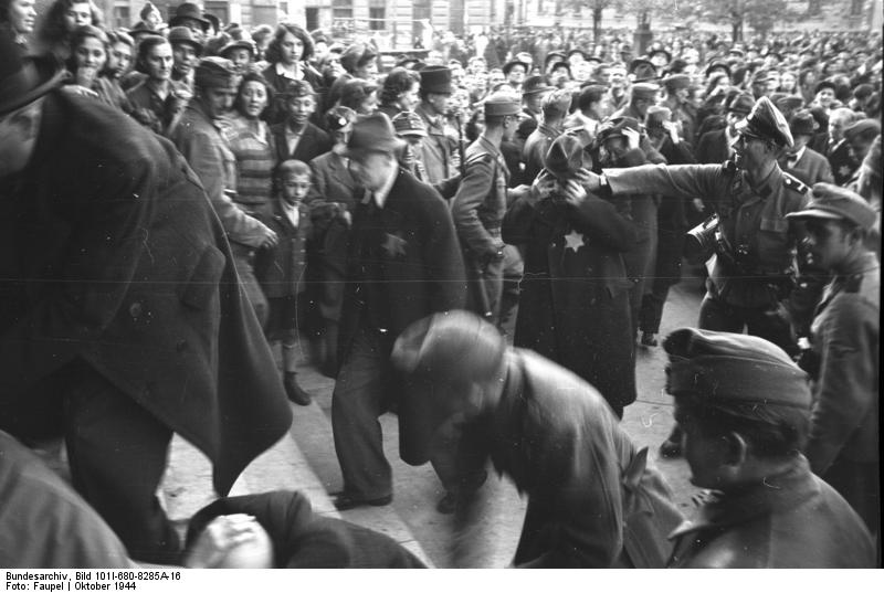 German and Hungarian forces gathering Jews for deportation in Budapest in 1944. Credit: The German Federal Archives.