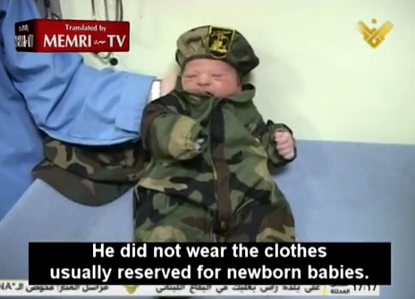 A Lebanese baby boy dressed in Hezbollah military fatigues as his first outfit. Credit: YouTube/MEMRI.
