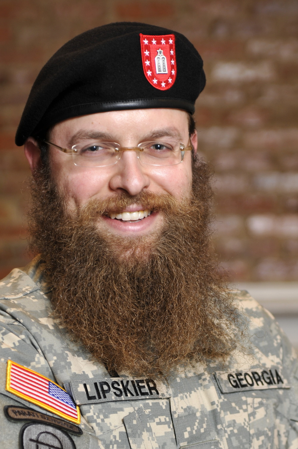 Click photo to download. Caption: In March 2008, the Georgia State Defense Force approved its first waiver for a beard when Rabbi Zalman Lipskier, pictured here, was commissioned as a chaplain. Credit: Duane Stork via Wikimedia Commons.