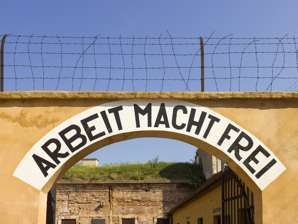"Click photo to download. Caption: The Theresienstadt concentration camp archway with the phrase Arbeit Macht Frei, meaning ""work makes (you) free,"" that was placed over the entrance in a number of Nazi concentration camps. Israeli Deputy Defense Minister Danny Danon wrote on International Holocaust Remembrance Day for JNS.org. Credit: Godot13 via Wikimedia Commons."