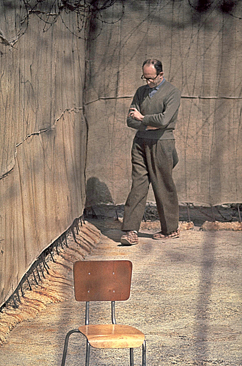 Nazi war criminal Adolf Eichman walks in the yard of his cell in Israel's Ayalon Prison in April 1961. Credit: Israeli Government Press Office.