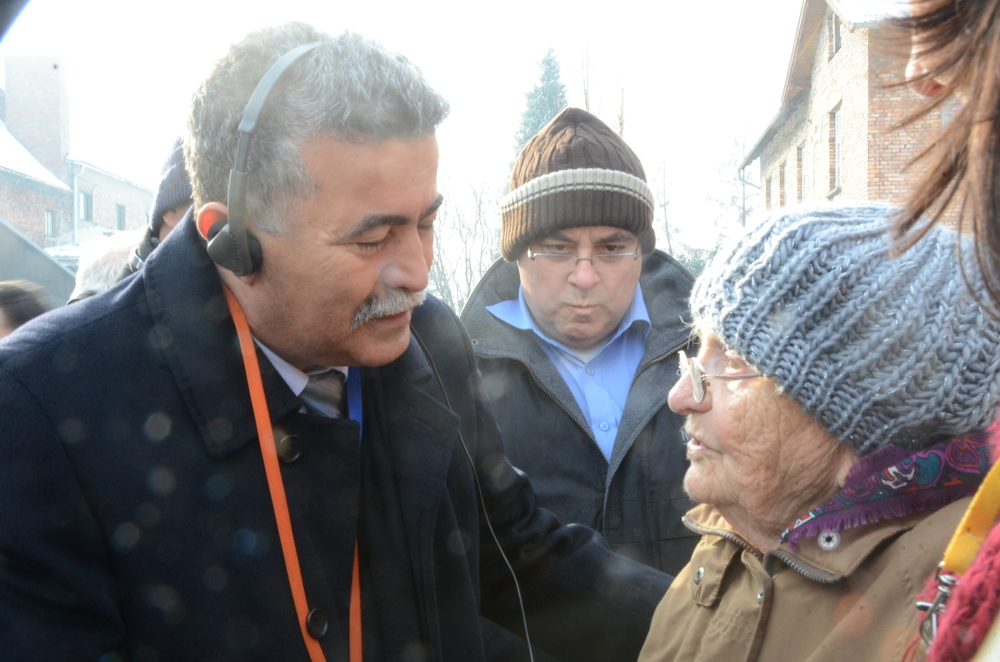 Click photo to download. Caption: Member of Knesset Amir Peretz (Hatnuah) listens to Zipora, an Israeli woman who survived Auschwitz, on International Holocaust Remembrance Day, Jan. 27, 2014. Credit: Maxine Dovere.