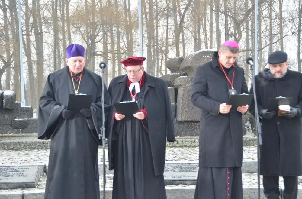 Click photo to download. Caption: On International Holocaust Remembrance Day (Jan. 27) at Auschwitz, Polish Chief Rabbi Michael Schudrich (far right) marks the occasion with other clergymen. Credit: Maxine Dovere.