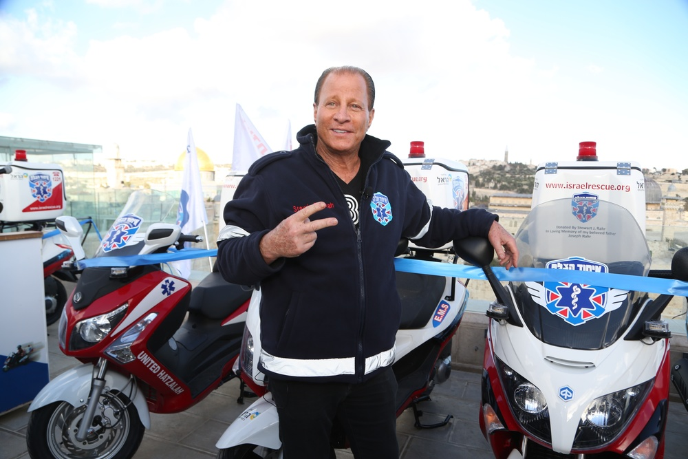 Click photo to download. Caption: Billionaire philanthropist Stewart Rahr pictured with ambucycles at a Jan. 28 event in Jerusalem that honored him for donating 50 ambucycles worth a total of $1.3 million to United Hatzalah. Credit: United Hatzalah.