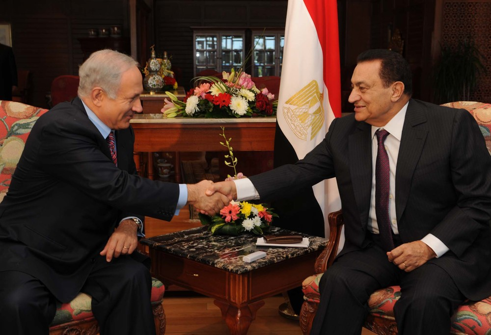 Israeli Prime Minister Benjamin Netanyahu shakes hands with then Egyptian President Hosni Mubarak in the Sinai Peninsula city of Sharem El Shich on May 11, 2009. Just three years after a revolution that toppled Mubarak, a military commander, Egypt's current top-ranked army officer, General Abdel-Fattah El-Sisi, has become the country's most popular political figure.  JNS.org  examines what an El-Sisi presidency would mean for Israel. Credit: Moshe Milner/GPO/FLASH90.