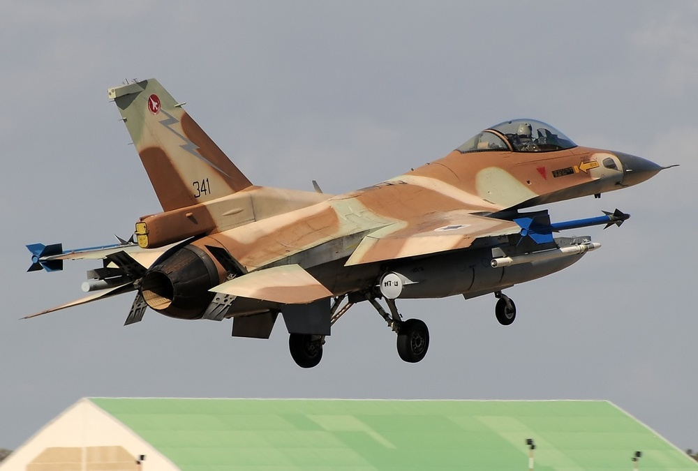 Click photo to download. Caption: The Lockheed Martin F-16C Barak plane, operated by the Israeli Air Force, takes off from Decimomannu Air Force Base in Italy. Lockheed Martin's 60-plus-year presence in Israel has to date primarily focused on aerospace and defense endeavors, but its partnership with the Jewish state will now expand to other areas such as cyber security as part of the new CyberSpark complex in Be'er Sheva. Credit: Aldo Bidini via Wikimedia Commons.