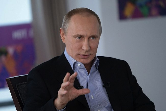 Click photo to download. Caption: Russian President Vladimir Putin gives an interview about the Sochi Olympics on Jan. 17, 2014. Credit:  Presidential Press and Information Office via Wikimedia Commons.