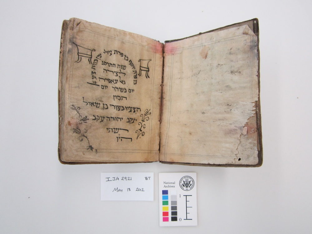 Click photo to download. Caption: Before treatment by the National Archives and Records Administration, a Passover haggadah from 1902 recovered from the Mukhabarat, Saddam Hussein's Intelligence Headquarters. The haggadah is part of what has become known as the Iraqi Jewish Archive. Credit: National Archives and Records Administration.
