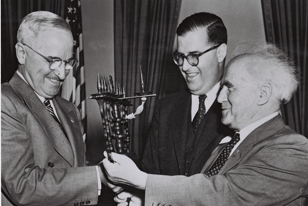 Click photo to download. Caption: U.S. President Harry S. Truman, Israeli Ambassador to the U.S. Abba Eban, and Israeli Prime Minister David Ben-Gurion in the White House on May 1, 1951. The Israeli leaders presented Truman with a menorah. Credit: Fritz Cohen via Wikimedia Commons.