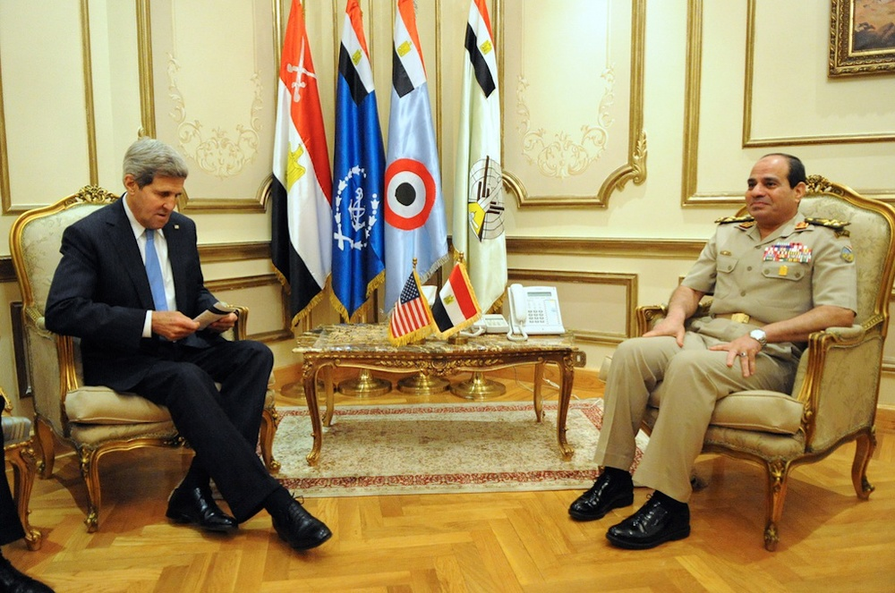 U.S. Secretary of State John Kerry reviews his notes before a meeting with Egyptian Minister of Defense General Abdel-Fattah el-Sisi (right) in Cairo, Egypt, on November 3, 2013. Credit: State Department.