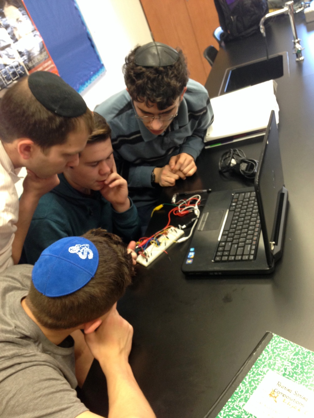 Click photo to download. Caption: Engineer Adam Jerozolim works with CIJE-Tech students at Solomon Schechter High School of Long Island. Credit: Provided photo.