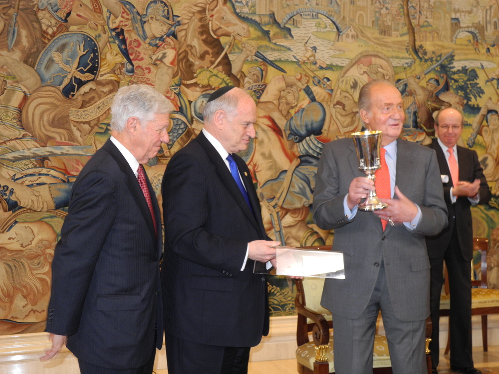 From left to right, Robert Sugerman, chairman of the Conference of Presidents of Major American Jewish Organizations, Malcolm Hoenlein, executive vice chairman of the Conference of Presidents, and King Juan Carlos I of Spain (holding Elijah's cup) in Madrid on Thursday. Credit: Conference of Presidents.