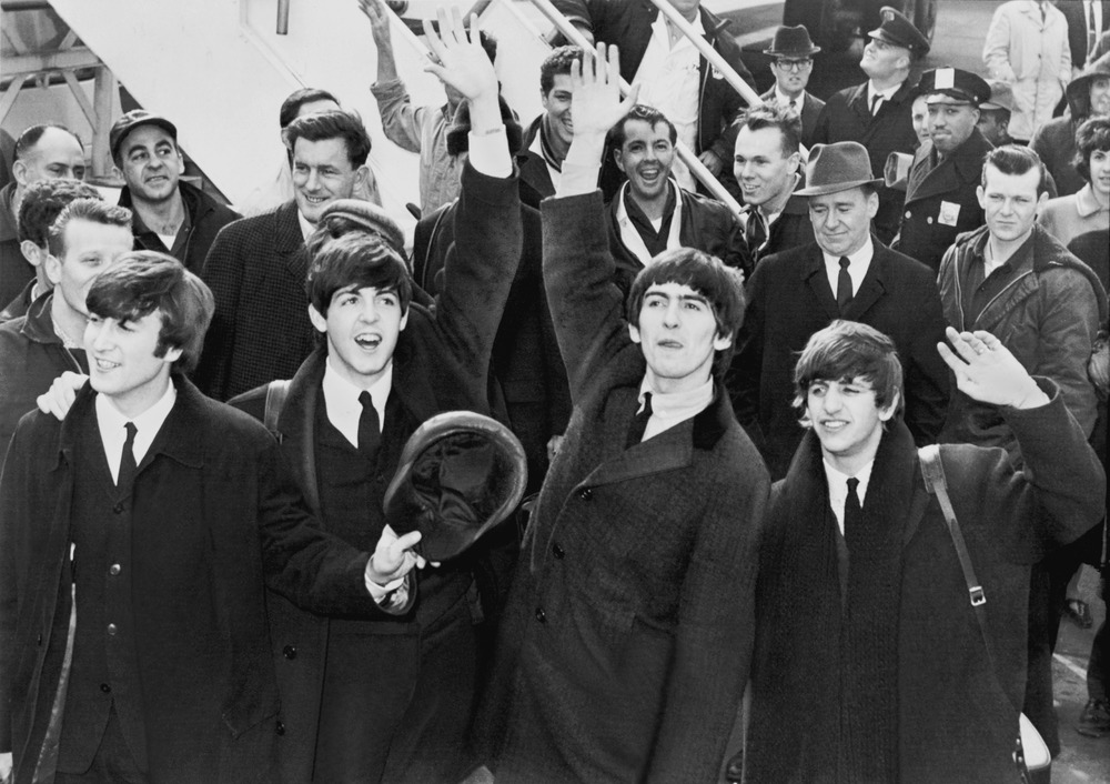 Click photo to download. Caption: The Beatles wave to fans after arriving at New York's John F. Kennedy International Airport on February 7, 1964, marking their first appearance in the U.S. Credit: Library of Congress via Wikimedia Commons.