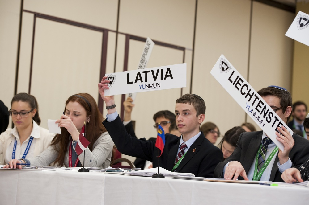 Click photo to download. Caption: At the 24th annual Yeshiva University National Model United Nations (YUNMUN) conference, holding the Latvia sign is Melvin J. Berman Hebrew Academy (Rockville, MD) sophomore Natan Kelsey, and holding the Liechtenstein sign is senior Isaac Soltz, from the same high school. Credit: Yeshiva University.