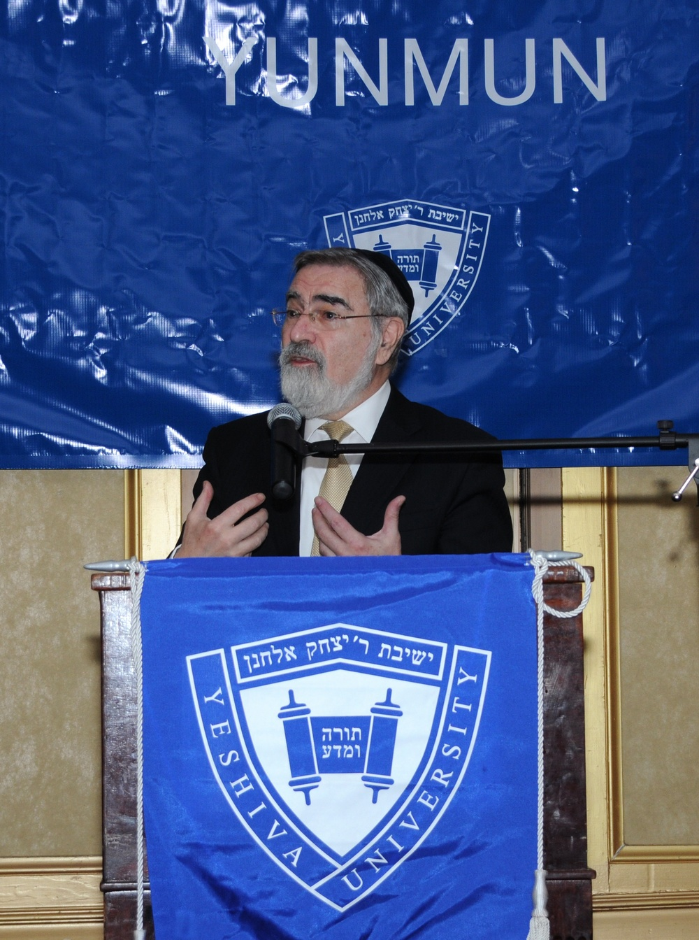 Click photo to download. Caption: Rabbi Lord Jonathan Sacks—former chief rabbi of the United Kingdom, who holds a dual professorship at Yeshiva University and New York University—speaks at the 24th annual Yeshiva University National Model United Nations (YUNMUN) conference. Credit: Yeshiva University.