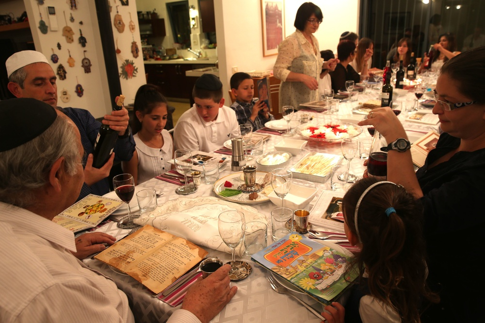 Click photo to download. Caption: A family seen during the Passover seder on the first night of the holiday in Tzur Hadassah, Israel, on March 25, 2013. Diaspora Jews observe two seders each year, as opposed to one seder per year in Israel. Credit: Nati Shohat/Flash 90.