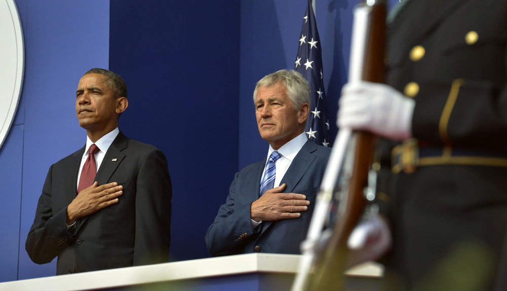 Click photo to download. Caption: President Barack Obama and Secretary of Defense Chuck Hagel place their hands over their hearts as the National Anthem is played in Washington, DC, on July 27, 2013. Obama's selection of Hagel was heavily criticized by the pro-Israel community, and now fresh concerns have arisen over the new appointment of Robert Malley—who had a falling out with the 2008 Obama presidential campaign over his meeting with the terror group Hamas—as a senior director at the National Security Council, where he will manage relations with the Persian Gulf states. Credit: DoD photo by Glenn Fawcett.