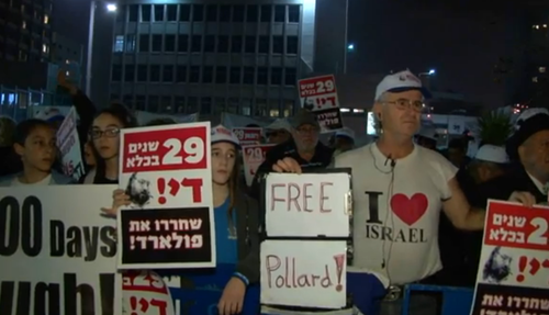 A demonstration for Jonathan Pollard's release on Sunday night in Tel Aviv. Credit: Israel Hayom video screenshot.